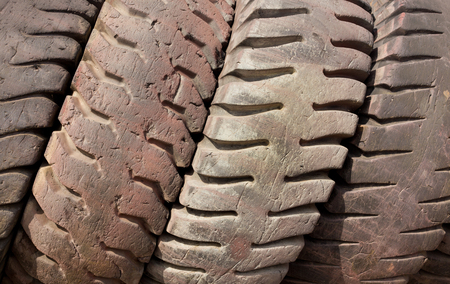 Old used tires lined to one another photo
