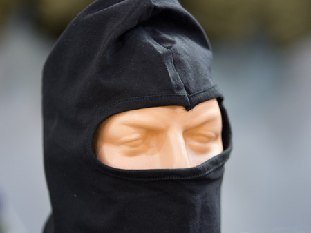 counterterrorism: Mask for police forces on a doll