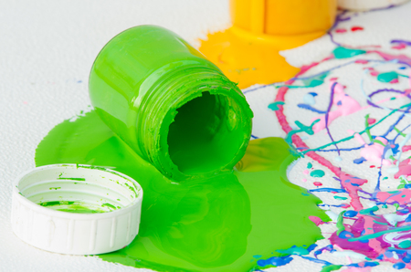 Used and spilled plastic paint bottles photo
