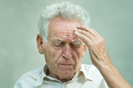 old man with headache photo