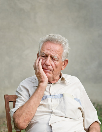 grizzle: forgetful old man Stock Photo