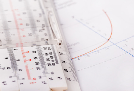 logarithmic: Logarithmic function on paper and old ruler for calculating