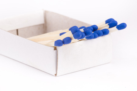 unlit: Close up of blue matches in box isolated on white background Stock Photo
