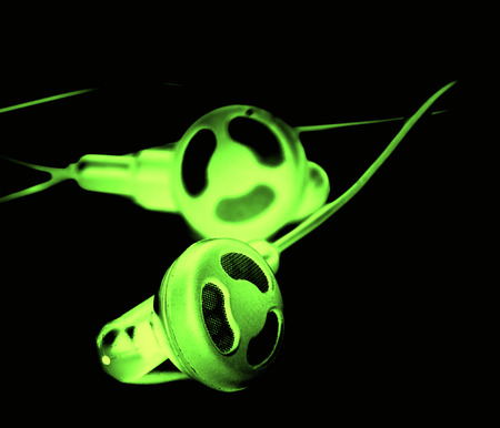 Green glowing headset isolated on black background photo