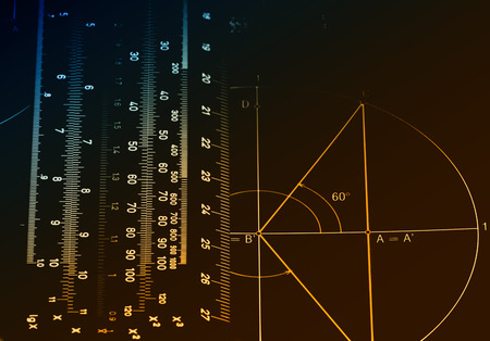 educational problem solving: Illuminated numbers and graphic on dark background Stock Photo