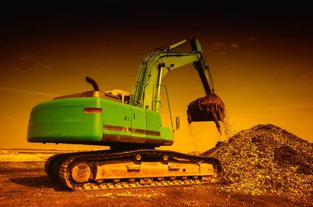 dredger: Big dredger digging building material waste and making space on site