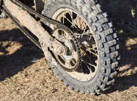 maschine: Close up of mud motorcycle tire after offroad race Stock Photo