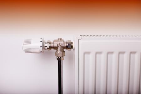 regulating: Close up of heating thermostat on radiator