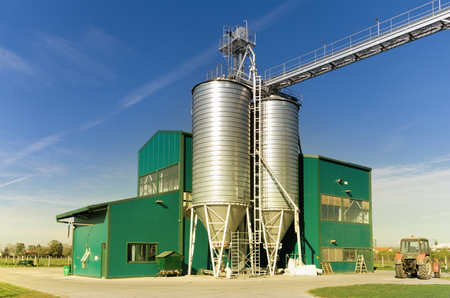 granary: Grain silos with warehouse courtyard on sunny day