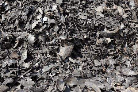 Close up of old shredded tires on pile