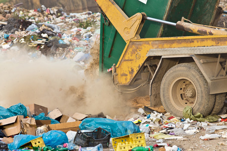 tipping: Truck tipping garbage from container on junk yard Stock Photo