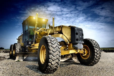 gravel roads: Grader is working on the road construction