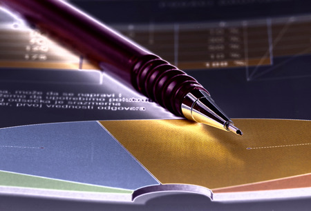 soft tip pen: Close up of graphs and paper statements for finance concept