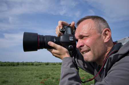 telephoto: Photographer in action with telephoto lens