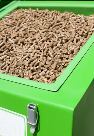 wood pellets: Close up of wood pellets in green container