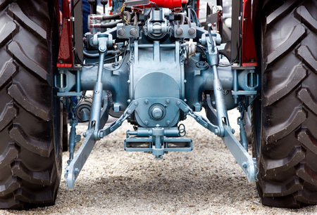 hooking: Rear view of new modern red tractor