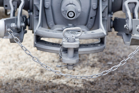 tow tractor: Close up of new tractor hitch with tow bar and chains, rear view