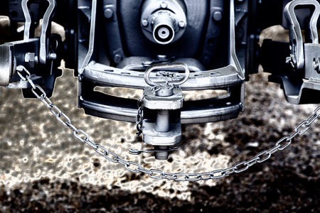 hitch: Close up of new tractor hitch with tow bar and chains, artistic effects, rear view