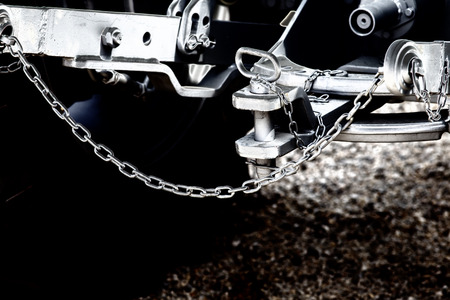 hitch: Close up of new tractor hitch with tow bar and chains, artistic effects on image