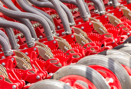 agriculture machinery: Close up of pipes and wheels of agricultural machinery, seeder Stock Photo
