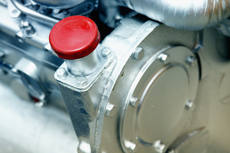 compression tank: Close up of cap screw on the engine Stock Photo