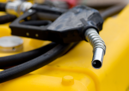 bio diesel: Close up of fuel nozzle on the yellow tank for agricultural purposes Stock Photo