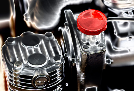 injection valve: Close up of cap screw on the engine, artistic image technique Stock Photo