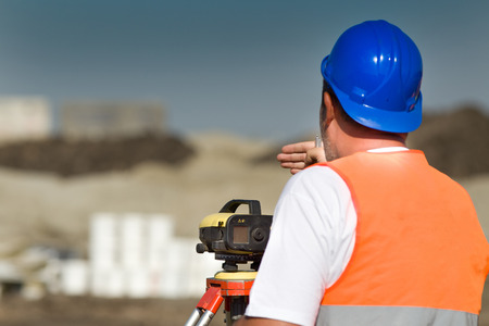 geodetic: Surveyor engineer working with theodolite on road construction site Stock Photo