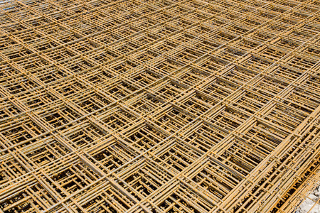 reinforcing bar: Abstract image of reinforcement steel mesh for concrete slabs