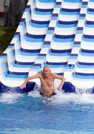 aqua park: Senior man enjoying holiday in aqua park