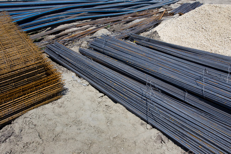 ribbed slab: Close up of rebar, reinforcement mesh and pvc pipes on the ground at construction site