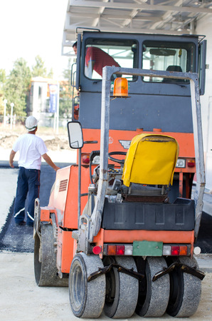 asphalting: Roller compactors for asphalting parked on building site Stock Photo
