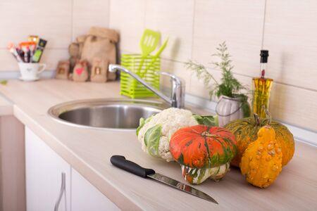 luz natural: Close up of decorative pumpkins on kitchen countertop Foto de archivo