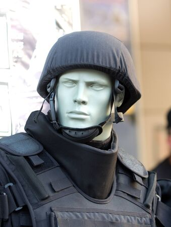 police helmet: Police helmet and safety vest on the doll