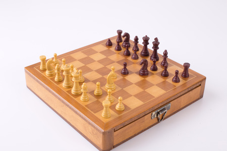 chess board: Wooden chess board with russian gambit isolated on white background