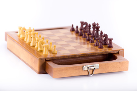 chessmen: Chessmen on wooden board isolated on white background