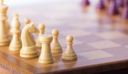 chessmen: Close up of chessmen on wooden board Stock Photo