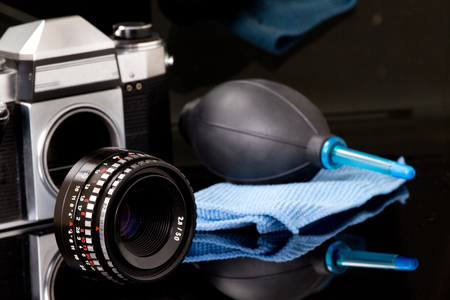 blowpipe: Cleaning kit for cleaning slr camera on black background with reflection Stock Photo