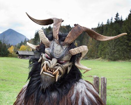 mask: Man wearing traditional Krampus beast-like mask from Alpine region Stock Photo