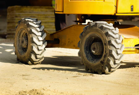 outside machines: Close up of construction vehicle wheels at building site Stock Photo