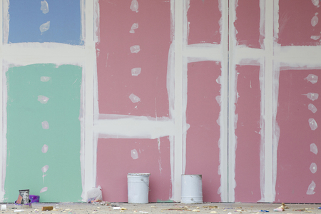 Front view of colorful gypsum wall with joints at building site