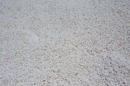 granulation: Small granulation of white marble pebble on pile Stock Photo