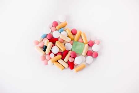 antidepressants: Group of different colorful drugs on white background