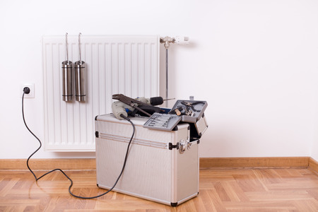 toolbox: Toolbox with different equipment for repairing heater in the room Stock Photo