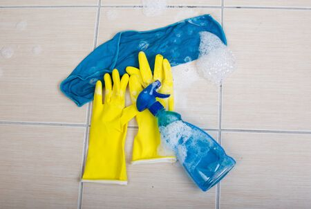 anti bacterial soap: Top view of cleaning equipment with foam on the tiled floor Stock Photo