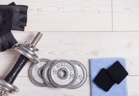 additional training: Sport lifestyle concept. Top view of dumbbells and accessories on the bright wooden floor
