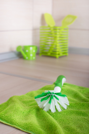 scrubbing: Scrubbing brush and cloth on the kitchen countertop