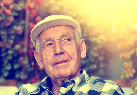 conceived: Portrait of  happy senior man smiling and thinking about something nice Stock Photo