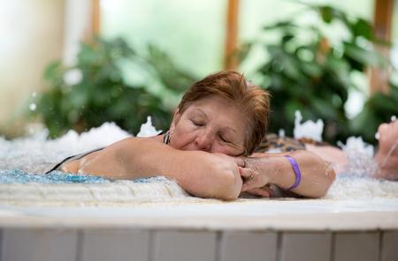 Senior woman resting in spa resort