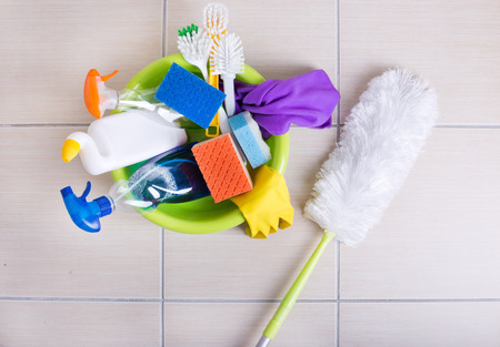 ceramic tile: Top view of washbasin full of cleaning supplies and equipment on the ceramic tile floor Stock Photo